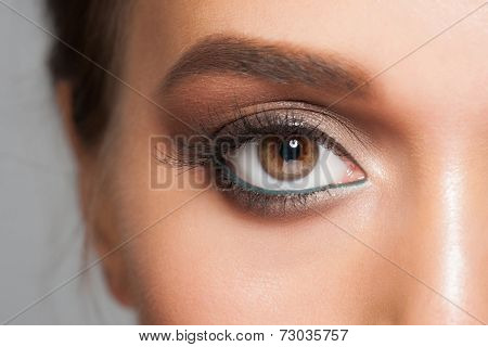 Closeup of beautiful woman eye with stylish bright makeup, macro