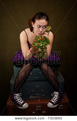 Pretty Girl In Purple On Green Background With Flowers