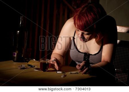 Young Woman Cutting Cocaine Or Heroin
