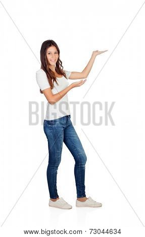 Attractive casual girl showing something isolated on a white background