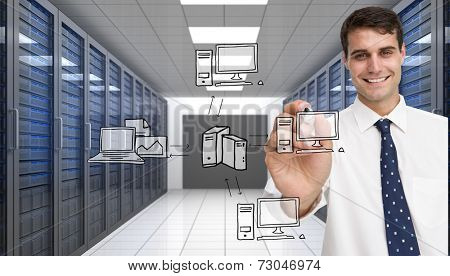 Smiling businessman holding marker against server room with towers