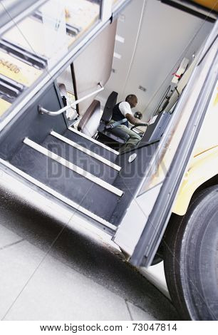 Low angle view of driver in school bus