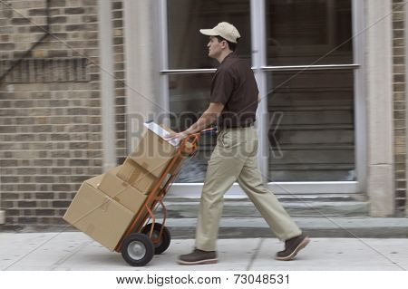 Side view of delivery man with boxes