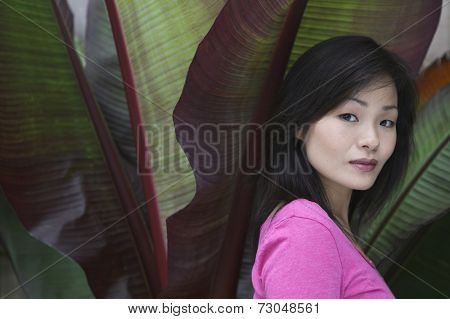 Portrait of woman and palm leaves