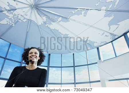 Businesswoman with earpiece