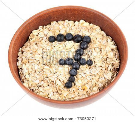 Brown wooden bowl with oatmeal and bilberries isolated on white