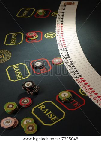 Gambling chips and dice on casino table