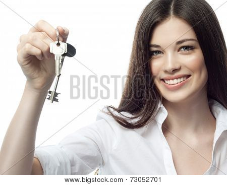 closeup portrait of attractive  caucasian smiling woman brunette isolated on white studio shot  toothy smile face  head and shoulders looking at camera  businesswoman keys hypothec real estate