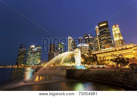 SINGAPORE-June 30,2014 : The Merlion at night on June 30,2014 in Singapore.The Merlion is a mythical creature with the head of a lion and the body of a fish, used as a mascot of Singapore.