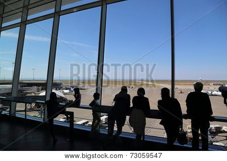 Vancouver, BC Canada - September 13, 2014 : People inside YVR airport watching air canada airplane in Vancouver BC Canada.