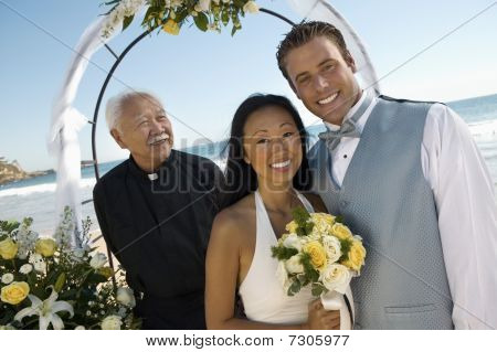 Bride and Groom with priest