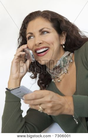 Woman Using Cell Phone and PDA close up