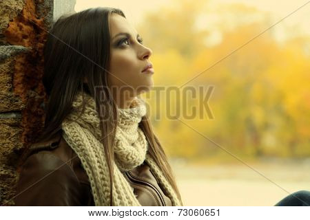 Portrait of young serious woman outdoors
