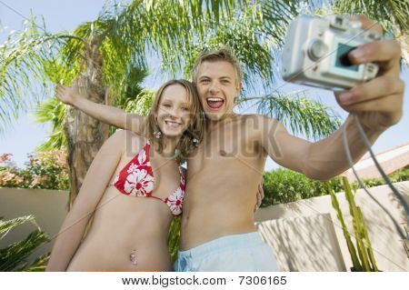 Young couple taking photo of themselves low angle view