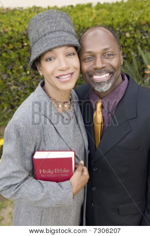 Religious Couple with Bible in garden portrait high angle view