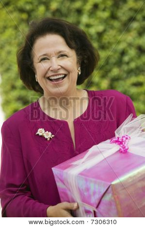 Senior Woman with Gift outside front view portrait