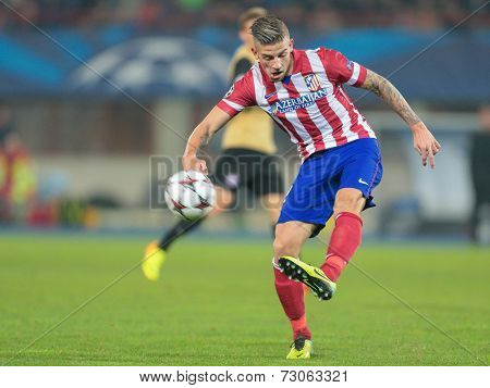 VIENNA, AUSTRIA - OCTOBER 22 Toby Alderweireld (#12 Atletico) kicks the ball at a UEFA Champions League game on October 22, 2013 in Vienna, Austria.