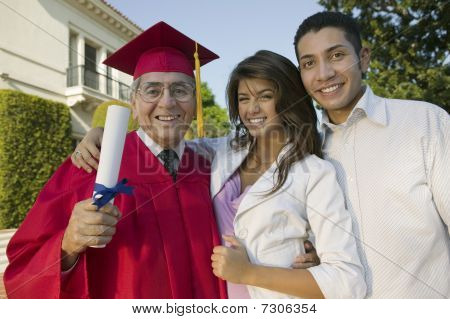 Senior Graduate with son and daughter outside portrait