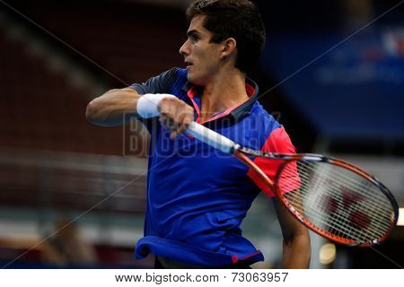 SEPTEMBER 23, 2014 - KUALA LUMPUR, MALAYSIA: Pierre-Hugues Herbert of France reacts after a return in his first round match at the Malaysian Open Tennis 2014. This is an ATP sanctioned tournament.