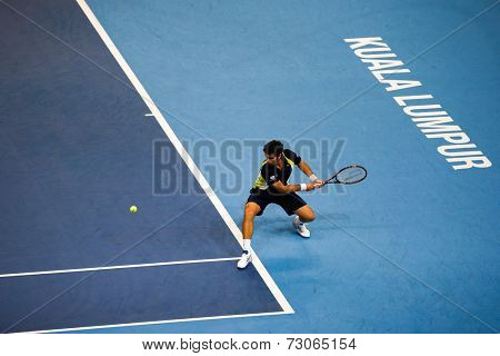 SEPTEMBER 25, 2014 - KUALA LUMPUR, MALAYSIA: Pablo Andujar of Spain makes a backhand return in his match at the Malaysian Open Tennis 2014. This is an ATP sanctioned tournament.