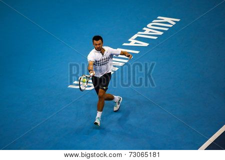 SEPTEMBER 25, 2014 - KUALA LUMPUR, MALAYSIA: Michal Przysiezny of Poland makes a forehand return in his match at the Malaysian Open Tennis 2014. This is an ATP sanctioned tournament.