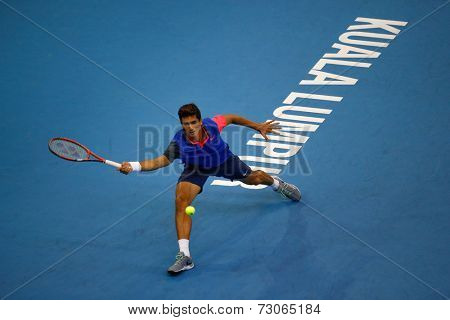 SEPTEMBER 25, 2014 - KUALA LUMPUR, MALAYSIA: Pierre-Hugues Herbert of France prepares to make a forehand return in his match at the Malaysian Open Tennis 2014. This is an ATP sanctioned tournament.