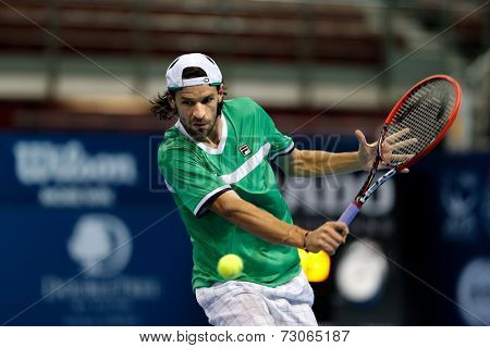 SEPTEMBER 25, 2014 - KUALA LUMPUR, MALAYSIA: Philipp Petzchner of Germany makes a backhand return in his match at the Malaysian Open Tennis 2014. This is an ATP sanctioned tournament.