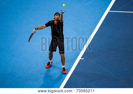 SEPTEMBER 25, 2014 - KUALA LUMPUR, MALAYSIA: Benjamin Becker of Germany tosses the ball to serve in his match at the Malaysian Open Tennis 2014. This is an ATP sanctioned tournament.