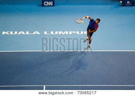 SEPTEMBER 25, 2014 - KUALA LUMPUR, MALAYSIA: Pierre-Hugues Herbert of France serves in his match at the Malaysian Open Tennis 2014. This is an ATP sanctioned tournament.