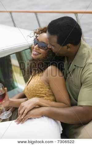 Ethnic Couple relaxing on white yacht (portrait)