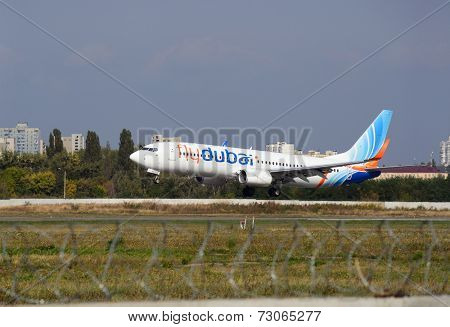 KIEV, UKRAINE - September 27, 2014: FlyDubai aircraft landing in Kiev International Airport
