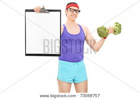 Nerdy athlete holding a clipboard and broccoli dumbbell isolated on white background