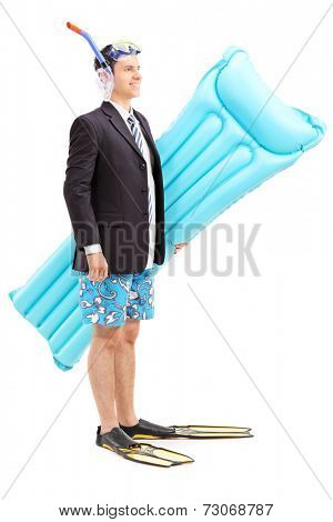 Man with suit and snorkel carrying swimming mattress isolated on white background