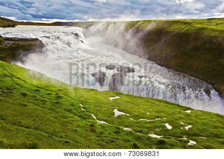 Scenic Gullfoss in Iceland. Water abyss. Over boiling water should cloud splash