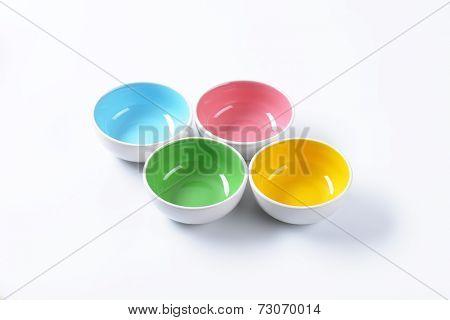 four colorful bowls