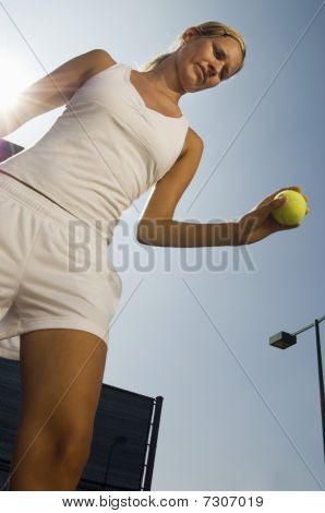 Tennis Player holding ball in hand Preparing to Serve low angle view