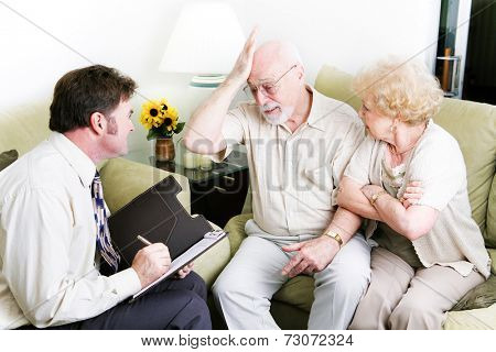 Senior couple in therapy.  Husband is feeling guilty.