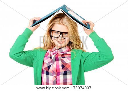 Portrait of a smart ten years girl in big glasses with a book. Isolated over white.