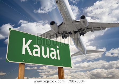 Kauai Green Road Sign and Airplane Above with Dramatic Blue Sky and Clouds.