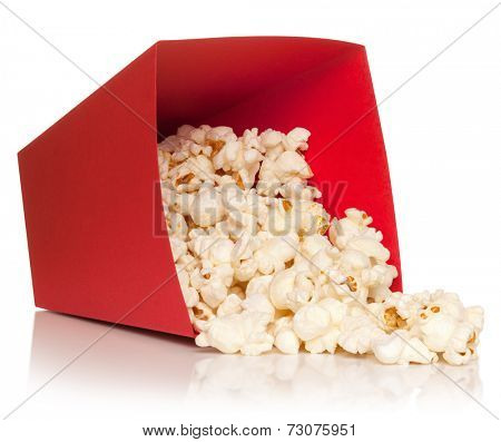 Red bucket with fallen out popcorn, isolated on the white background, clipping path included.