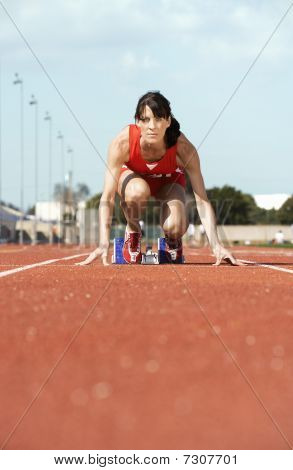 Female athlete on starting block