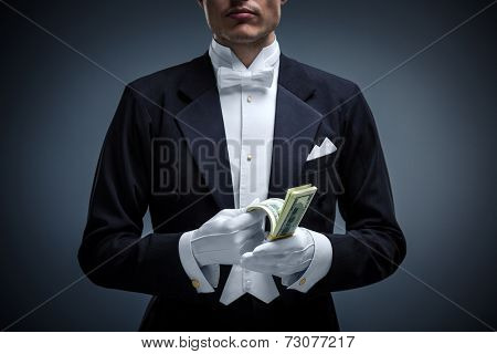 Man in a tuxedo with dollars