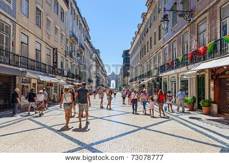 Lisbon, Portugal. August 31, 2014: Augusta Street with the Triumphal Arch seen at the end of it connecting the most famous Lisbon street to Terreiro do Paco Square aka Praca do Comercio.