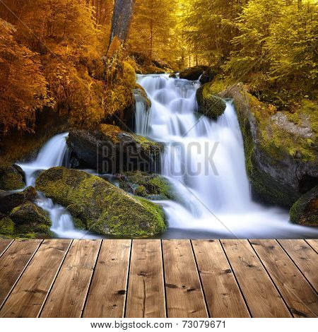 Autumnal landscape with waterfall