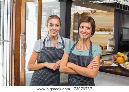 Pretty waitresses smiling at camera at the coffee shop