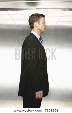 Businessman standing side view
