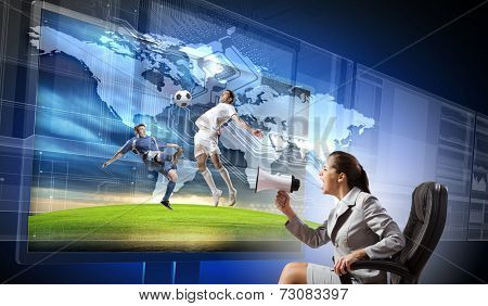 Emotional woman watching football match on 3 d tv