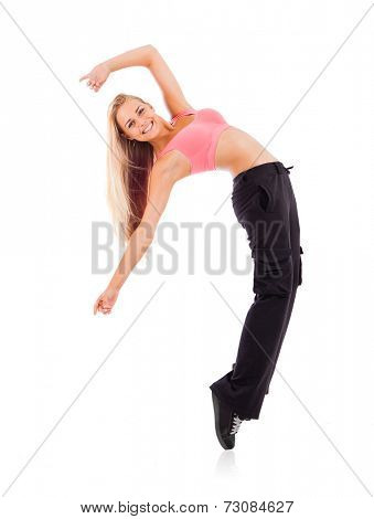 Young dancing woman isolated on white background