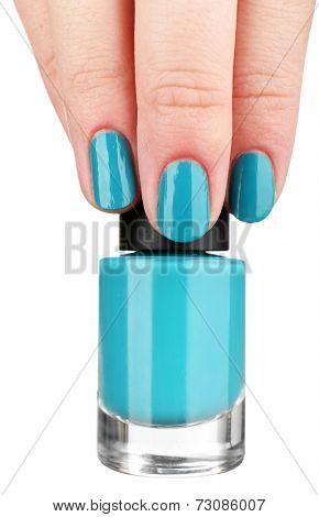 Nail polish in hand, isolated on white