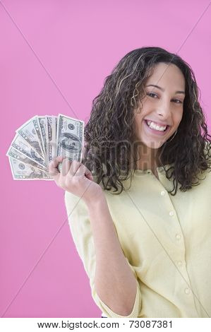 Teenage girl holding lots of cash
